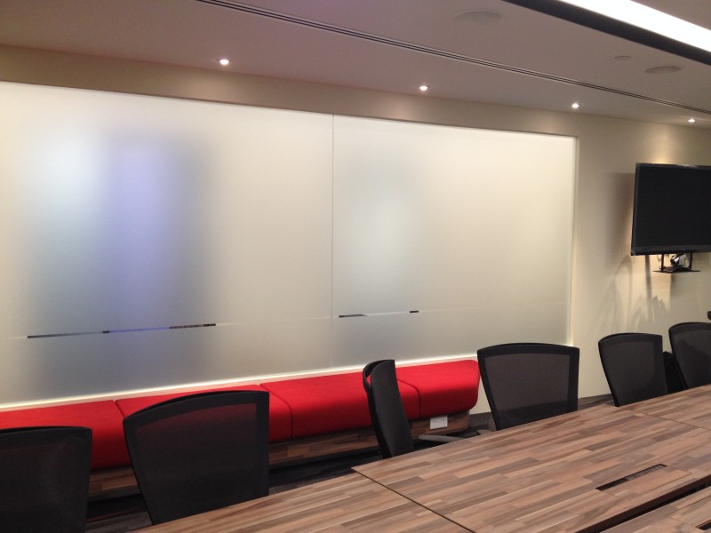 office_fitouts. Modern Meeting room design. Frosted tempered glass. Customised meeting room table.