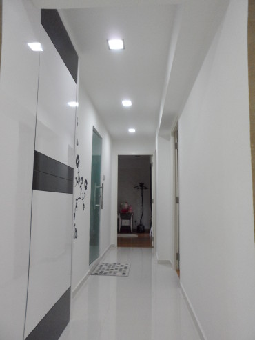 Living to bedrooms walkway. False ceiling with LED lights. Bomb shelther false door. Common bathroom with frosted tempered glass swing door.