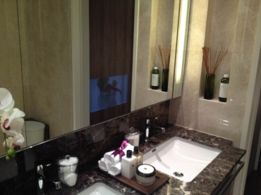 Residential Renovation for private condo. Luxury Bathroom interior design. Granite top. Designer wash basin and tap. LED lighting.