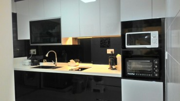 Modern High Contrast LED Kitchen. Back panel tempered glass. Glossy black kitchen cabinet. Soft close doors.
